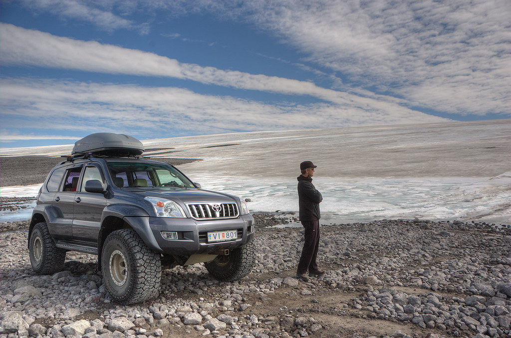 toyota Landcruiser at the edge of the glacier Langjökull. Self driving in Iceland